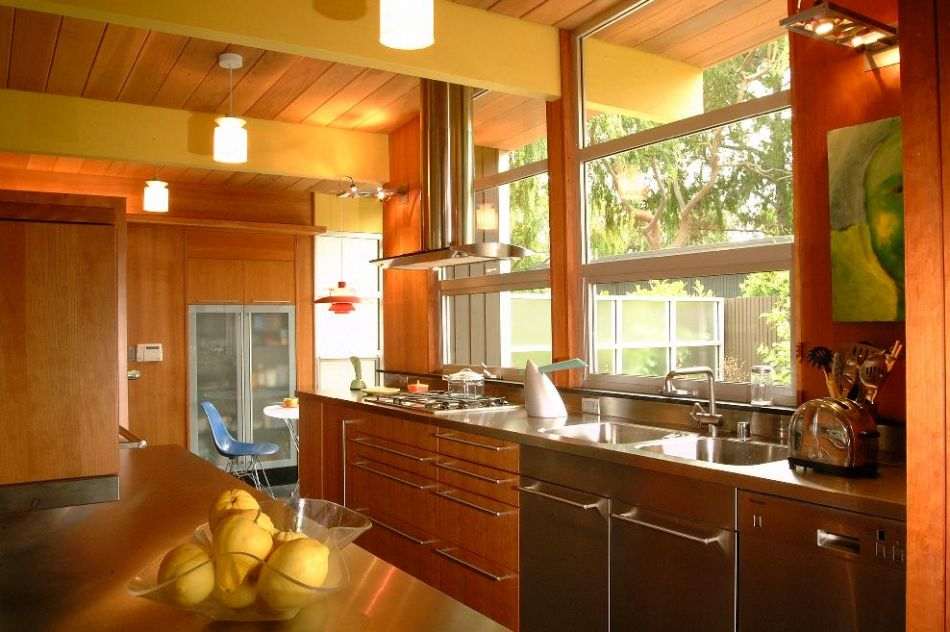 A kitchen warm with color and natural materials